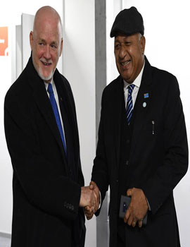 COP 23 President and Fijian Prime Minister, Frank Bainimarama shares a light moment with the Secretary-General's Special Envoy for the Ocean, Peter Thomson.Photo courtesy of Department of Information.