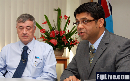AFL chairman Adrian Sofield with Fiji's Acting Prime Minister and Attorney General Aiyaz Sayed-Khaiyum during the handing over of $1m dividend cheque to government today. Photo: Avikash Chand.