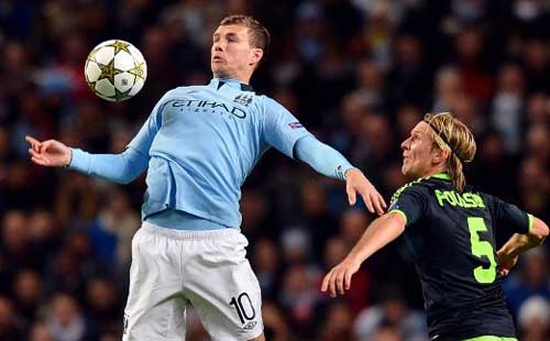 Dzeko late show sends Man City second