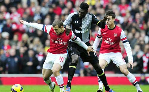Adebayor the fall guy as Arsenal swamp Spurs