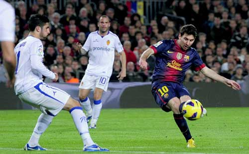 Messi double as Barca make record start to season